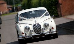 1961 Jaguar MK II in Old English White with chrome wire-wheels 11
