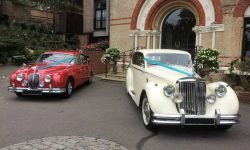 1964 Red MK II Jaguar and 1950 MK V Jaguar in Ivory