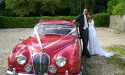 1964 Red MK II Jaguar with chrome wire-wheels