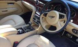 Latest model Bentley Mulsanne in White with cream leather interior and private plates (front interior)